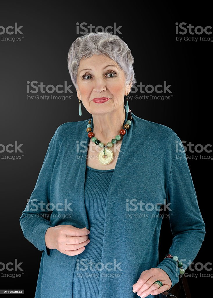 Spectacular old woman posing with semiprecious stone necklace stock photo