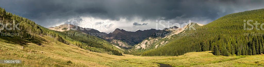 Spectacular Rocky Mountains Panoramic Valley View With Brewing Thunderstorm Storm stock photo