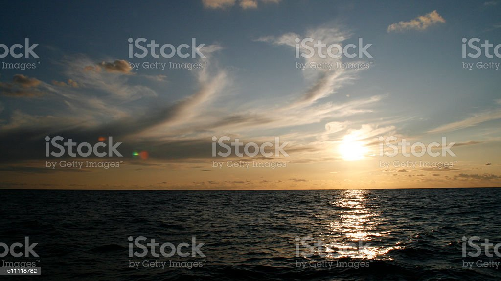 spectacular sunrise on the sea stock photo