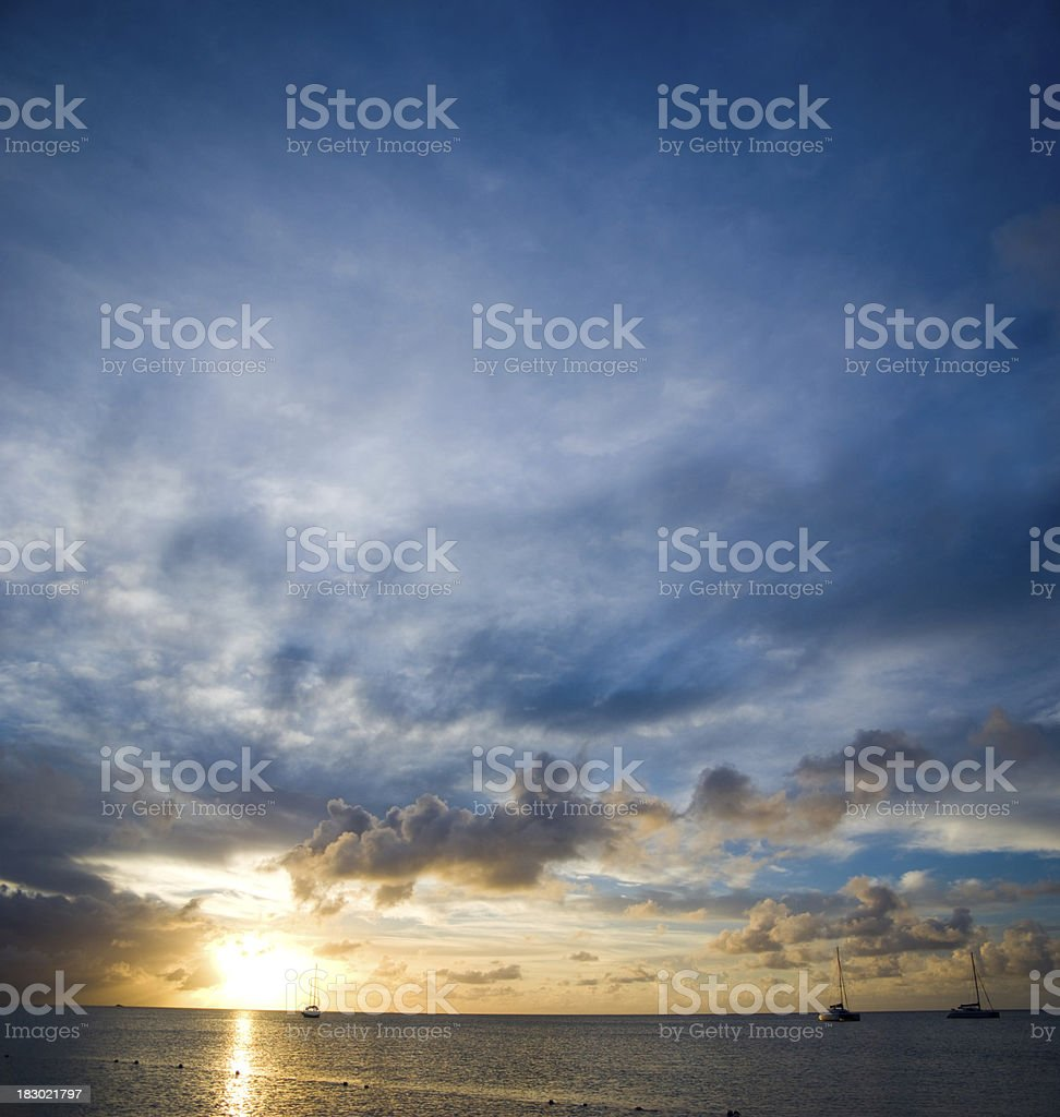 spectacular sunset and sailboats royalty-free stock photo