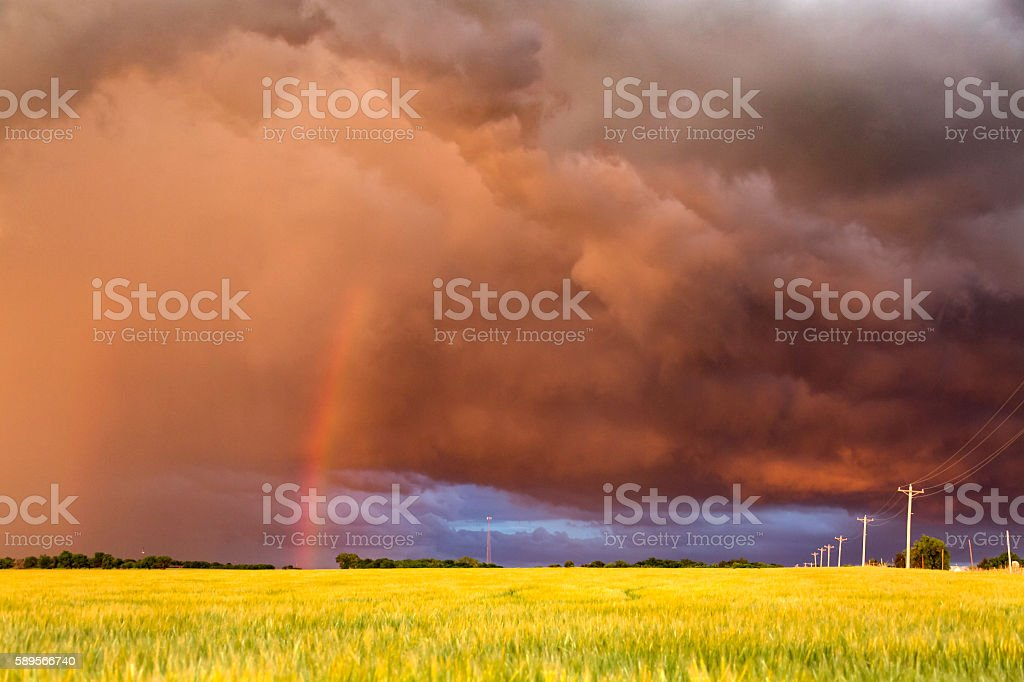 Spectacular sunset on storm clouds with rainbow in Tornado Alley stock photo
