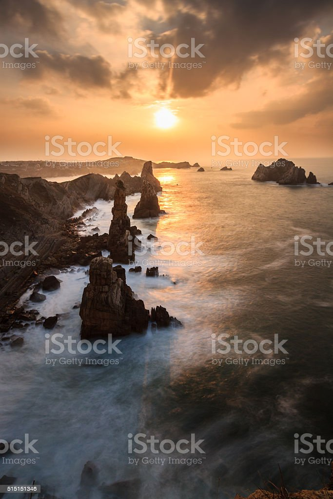 Spectacular sunset on the coast of Liencres, Cantabria, Spain stock photo