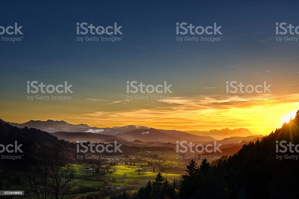 spectacular sunset over landscape at European alps in autumn stock photo