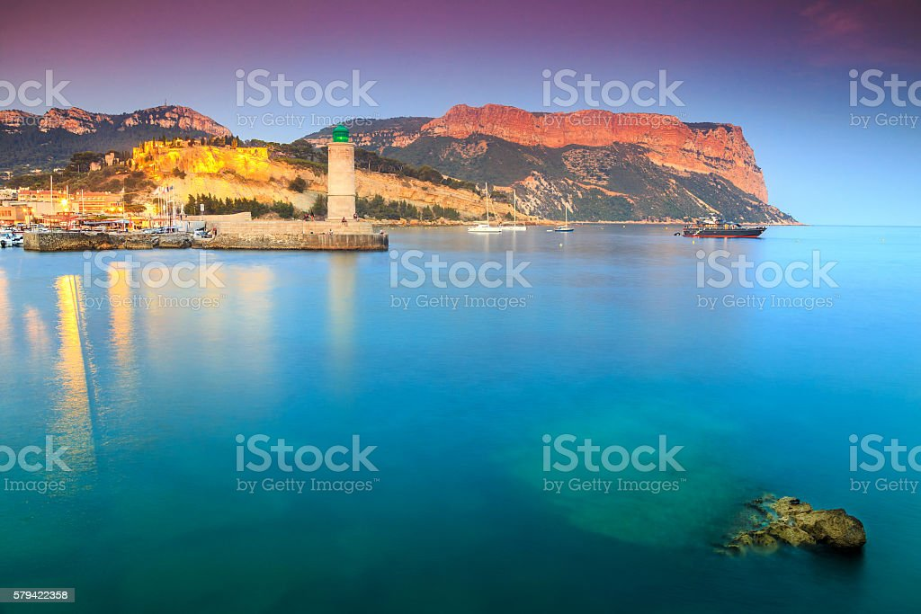 Spectacular sunset with Cassis lighthouse and Cap Canaille cliffs,France stock photo