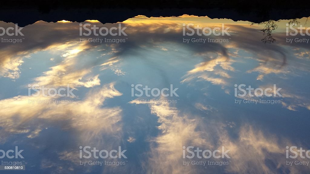 Spectacular twilight cloud formation stock photo
