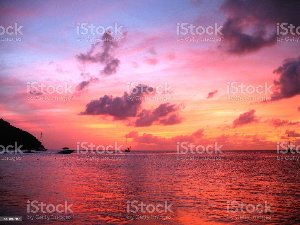 spectacular vivid caribbean sunset over sea stock photo