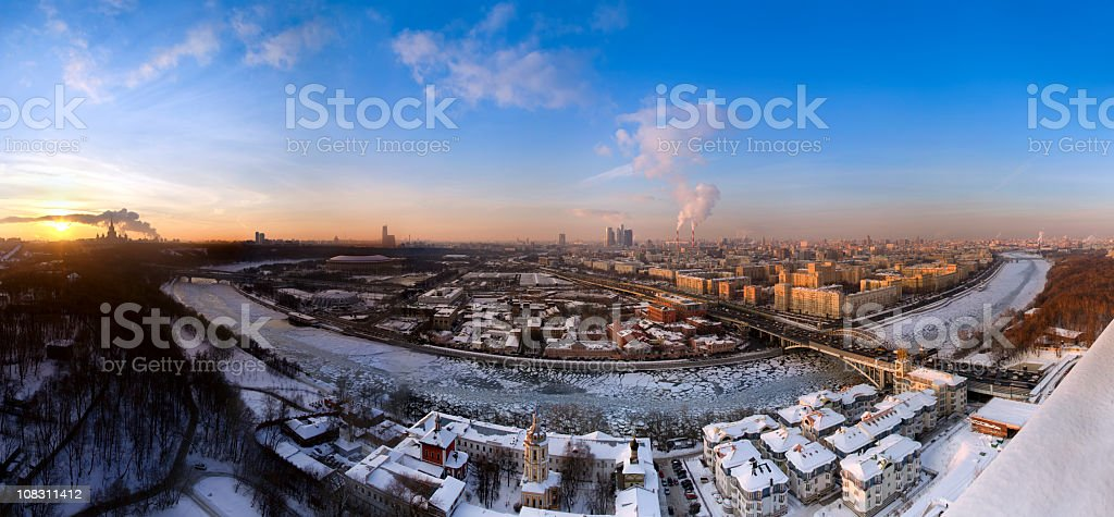 Spectacular winter panorama of Moscow with frozen river at sunset royalty-free stock photo