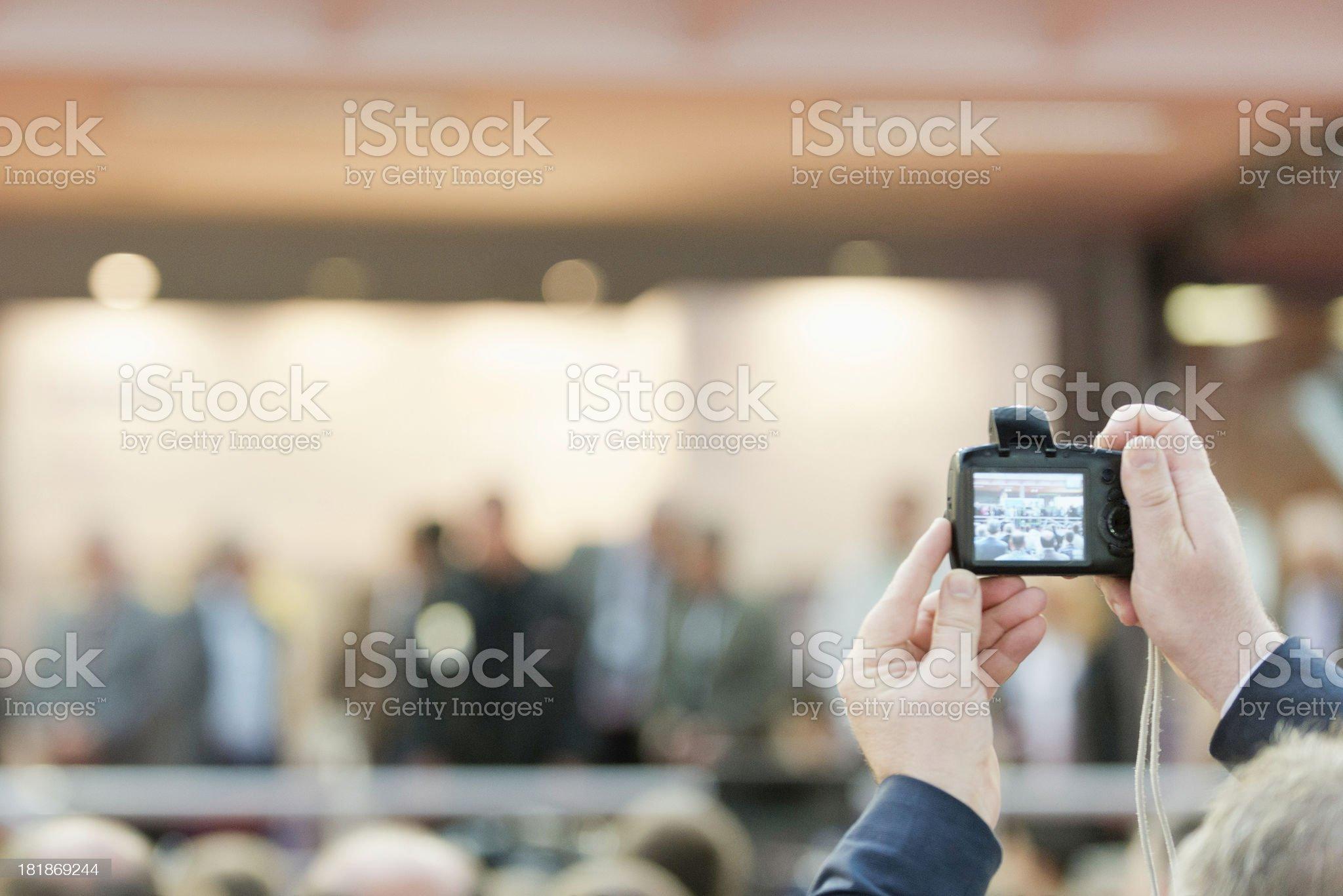 Spectator taking photo royalty-free stock photo