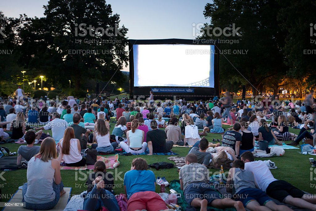 Spectators at Open-Air cinema stock photo