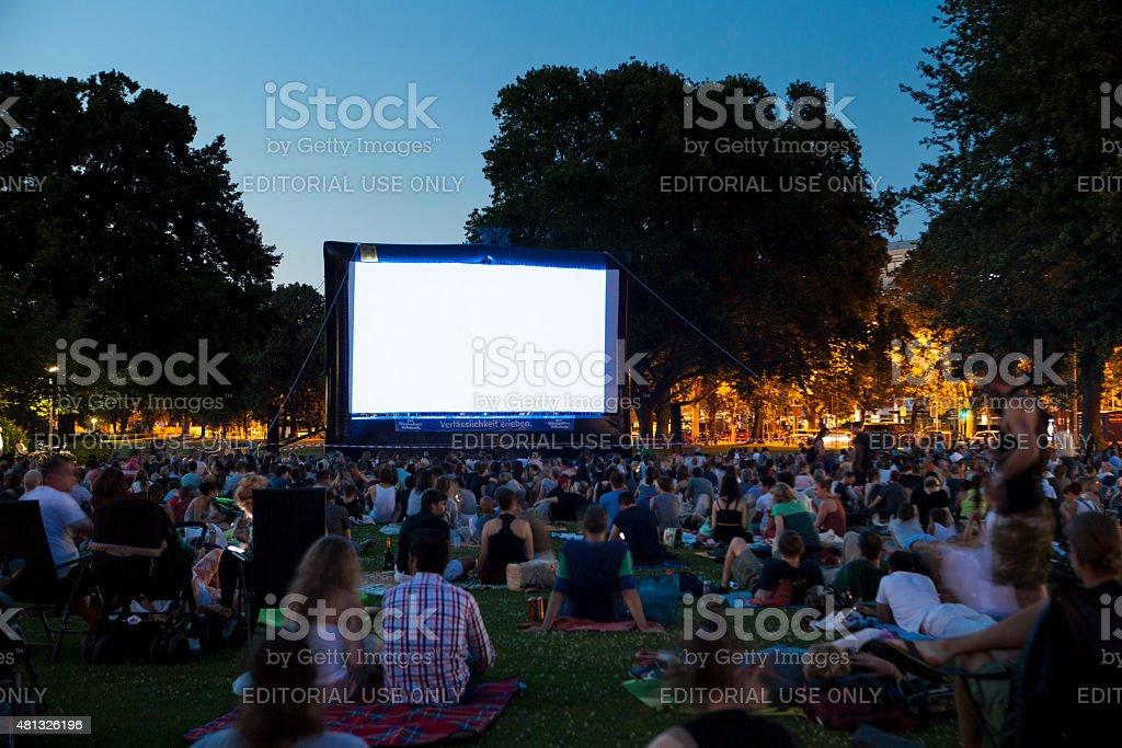 Spectators at Open-Air cinema summer night stock photo