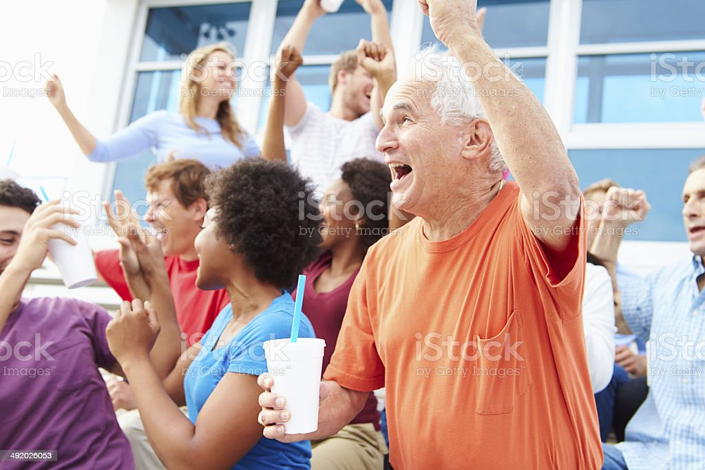 Spectators Cheering At Outdoor Sports Event stock photo
