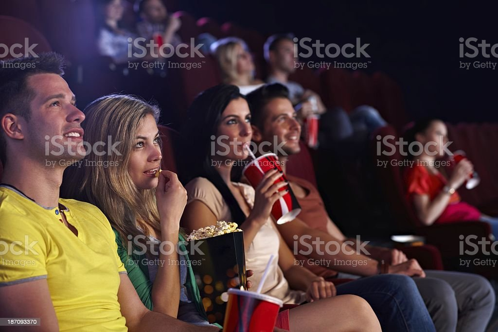 Spectators in multiplex movie theater stock photo