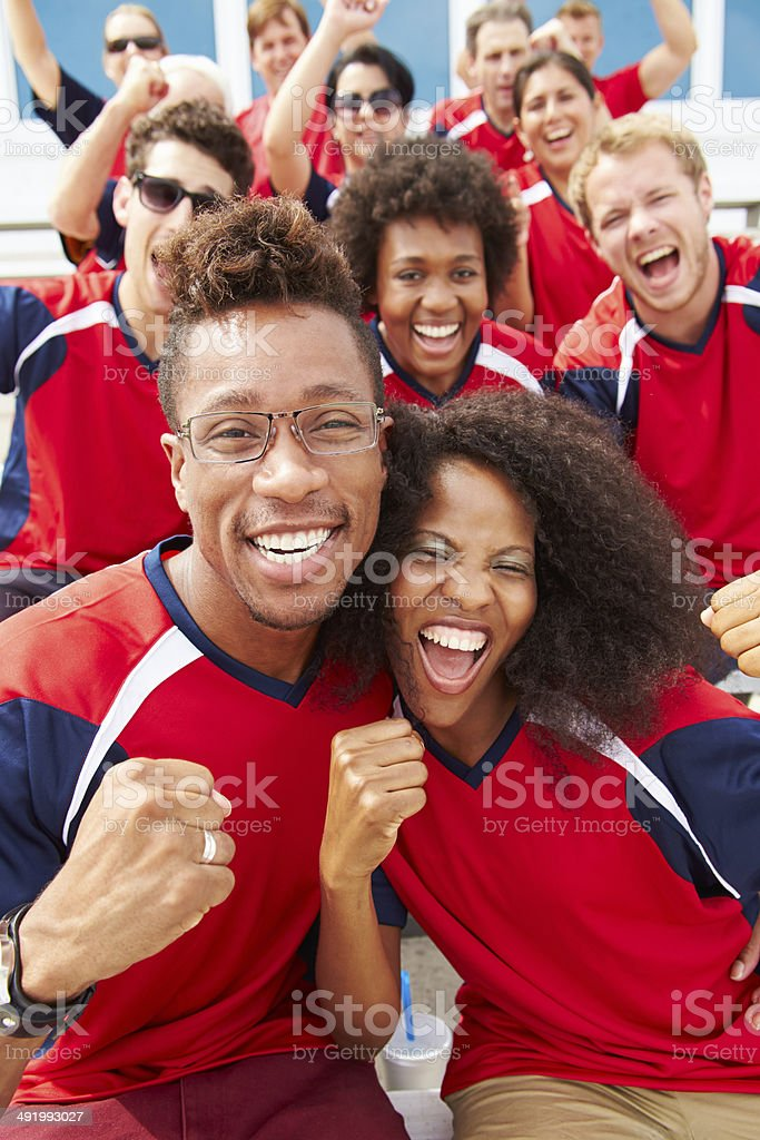 Spectators In Team Colors Watching Sports Event royalty-free stock photo