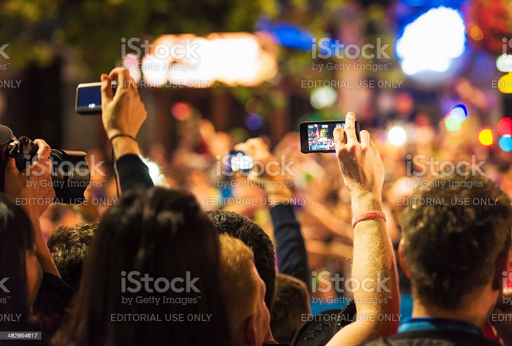 Spectators Photographing an Event stock photo