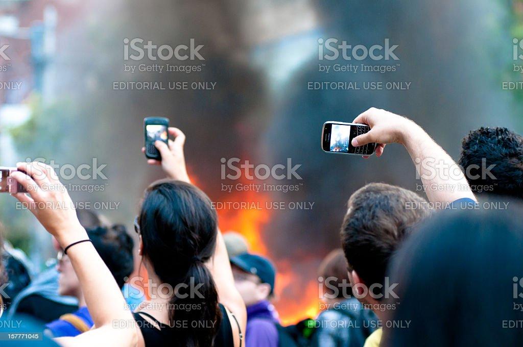 Spectators recording a fire stock photo