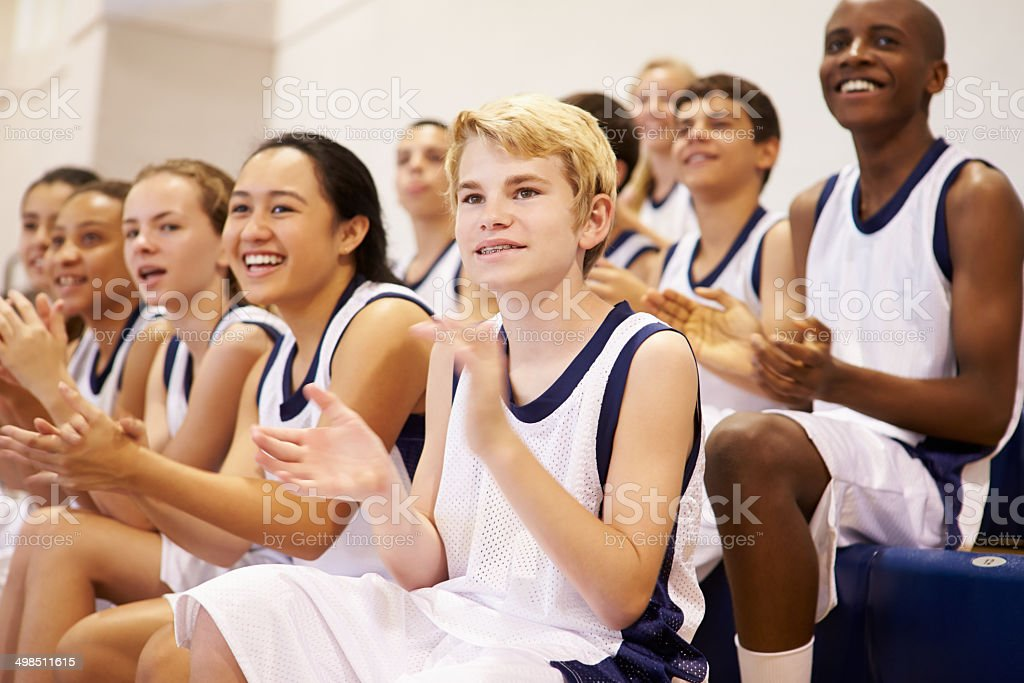 Spectators Watching High School Basketball Team Match stock photo