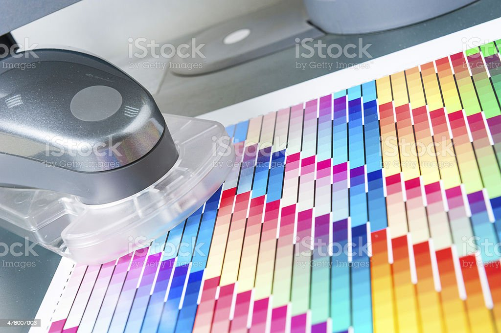 Spectrophotometer for Calibrating Printing Machines Reading CMYK Swatch royalty-free stock photo
