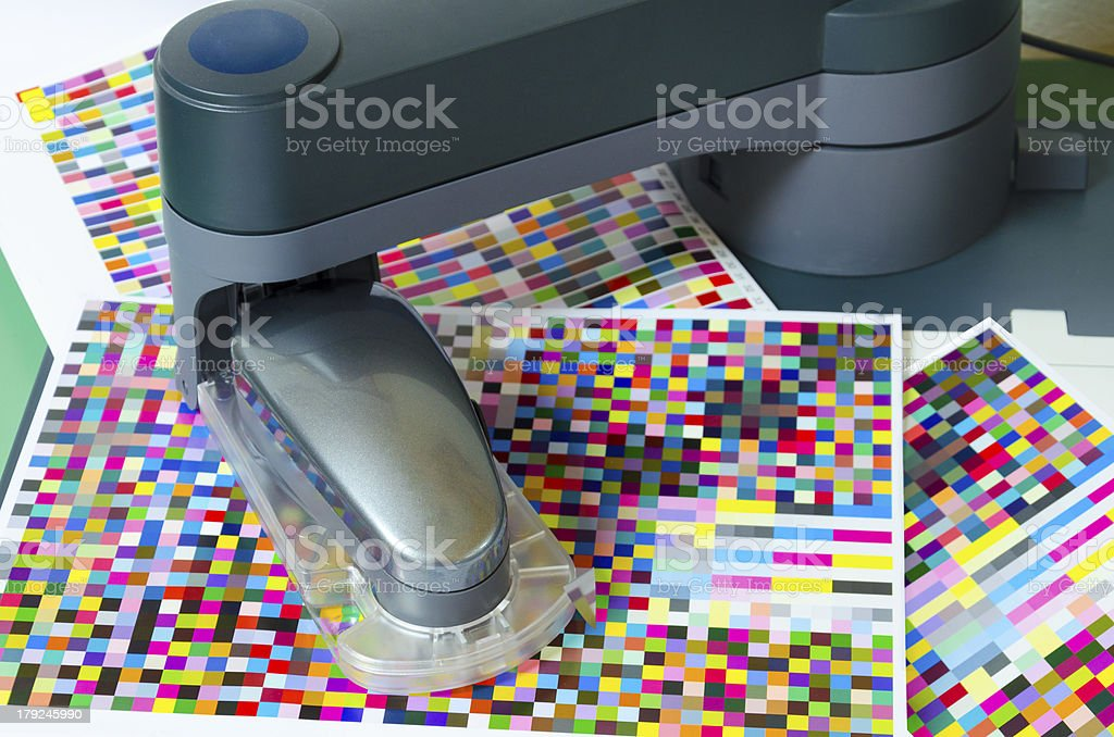 Spectrophotometer robot measuring color patches on test arch stock photo