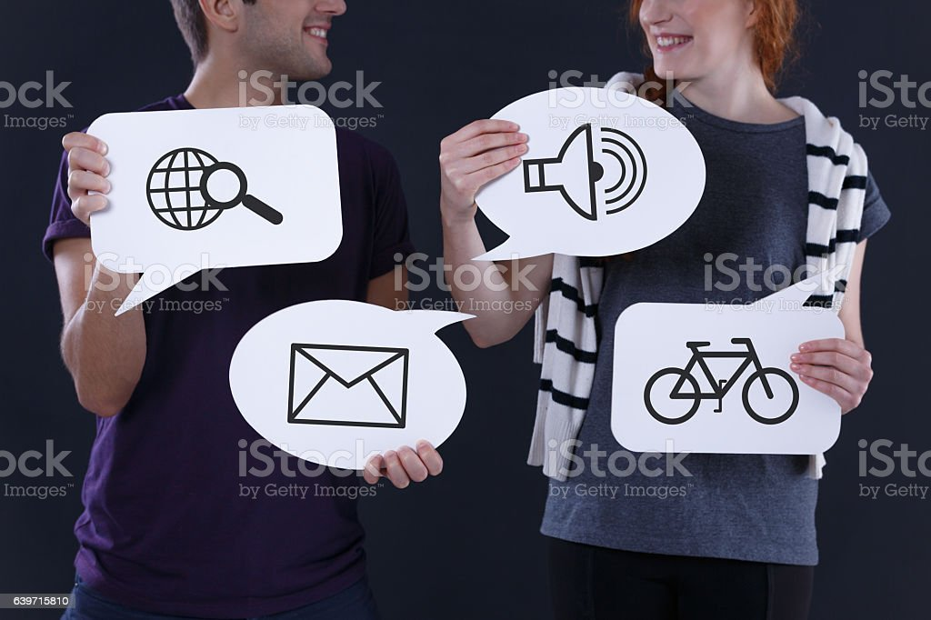 Speech balloons with common icons stock photo
