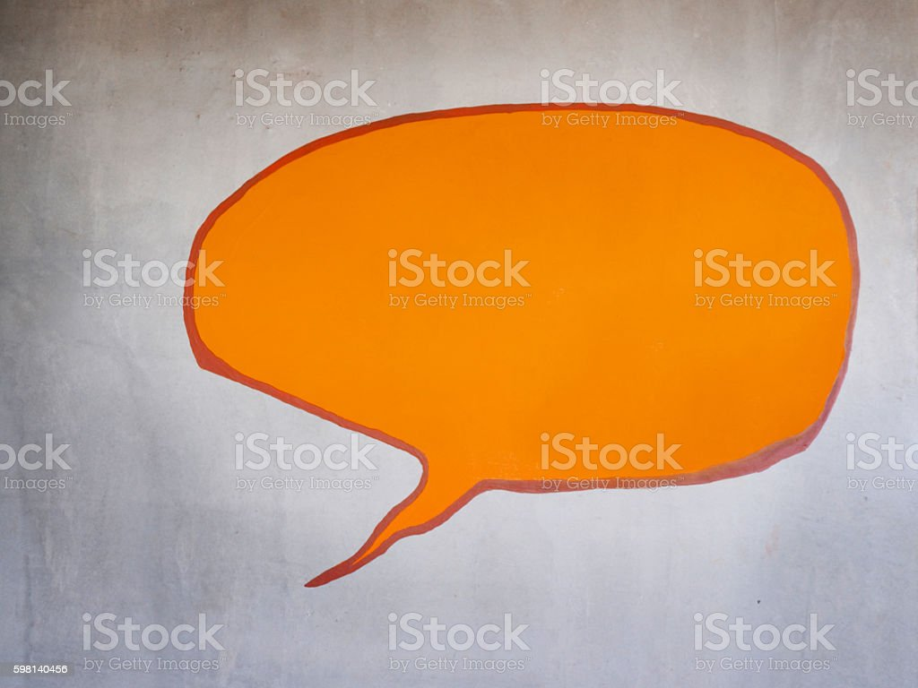 speech bubble on grey concrete wall stock photo