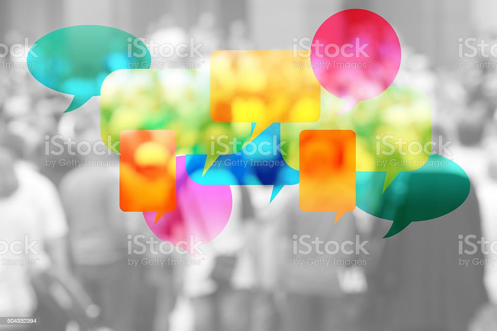 Speech Bubbles and people in background stock photo