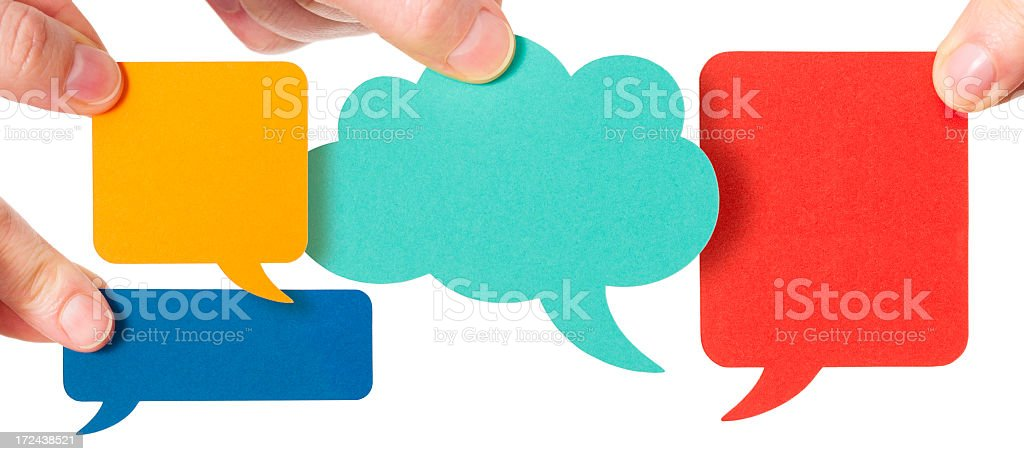 Speech bubbles arranged in a four way conversation royalty-free stock photo
