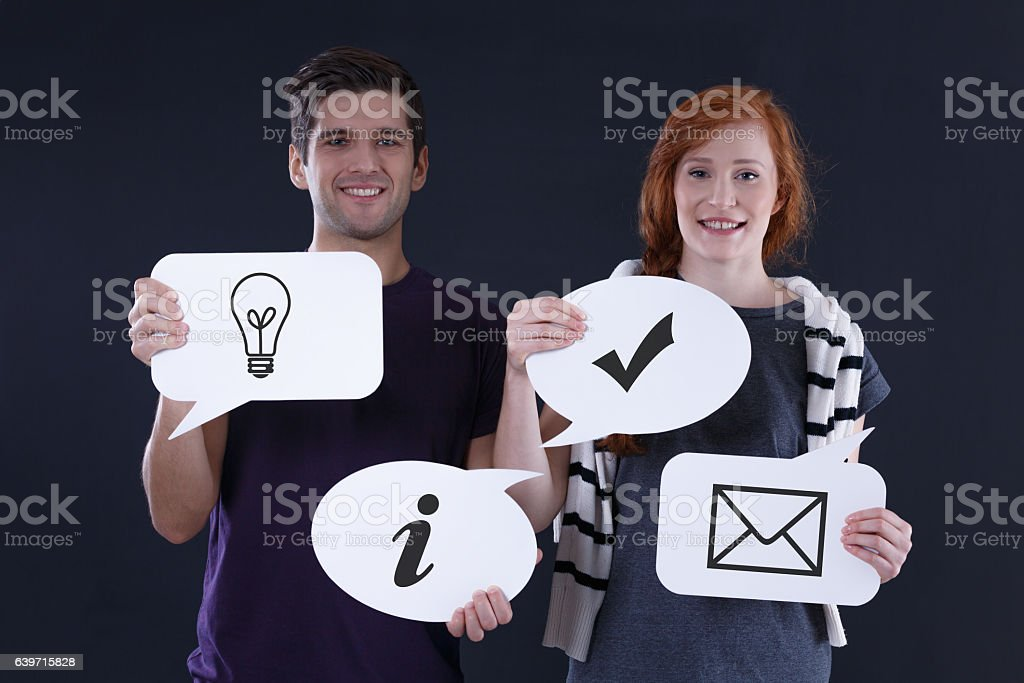 Speech bubbles with common icons stock photo