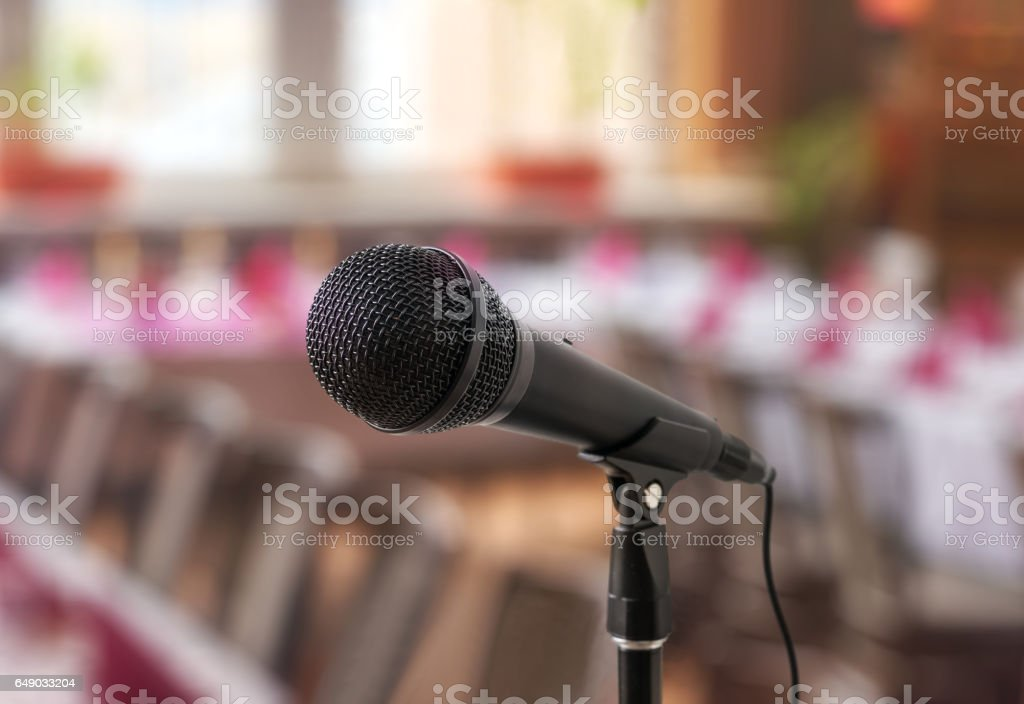 Speech or conference concept. Microphone on stand in front of...