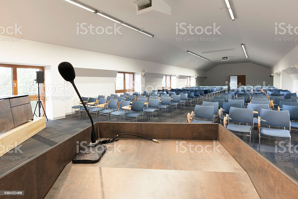 Speech podium in modern conference hall stock photo