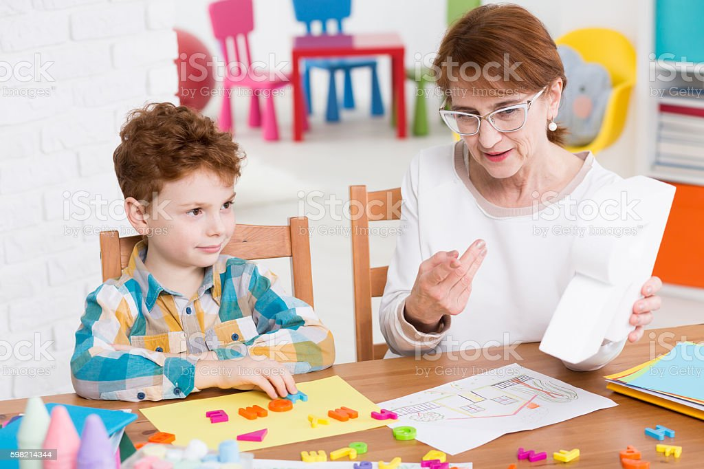 Speech therapist and little patient stock photo