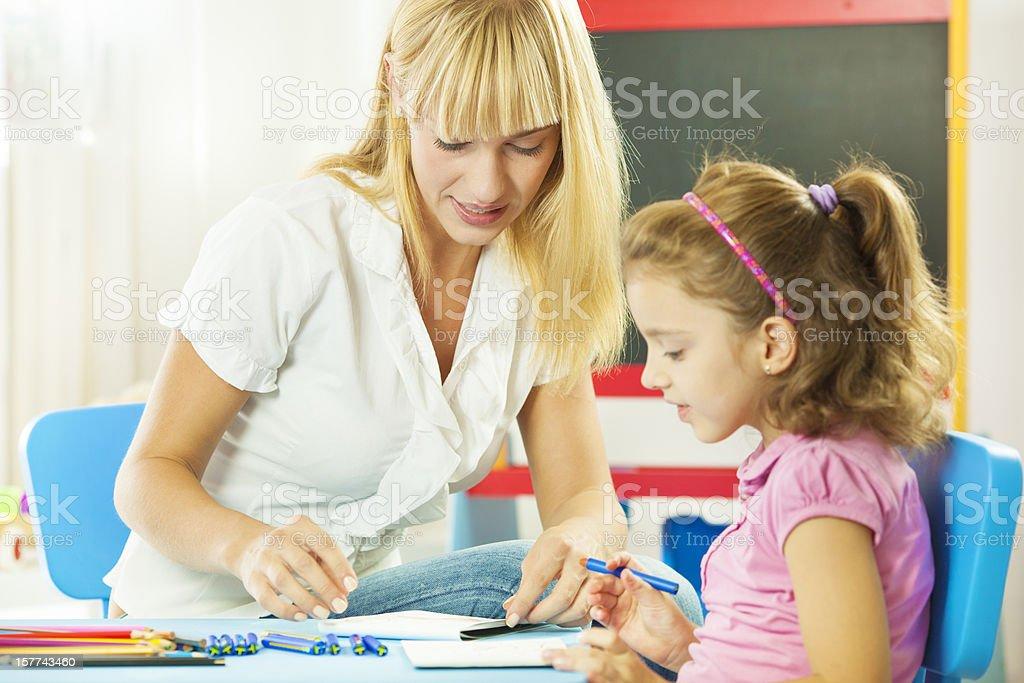 Speech Therapist Interacting with child stock photo