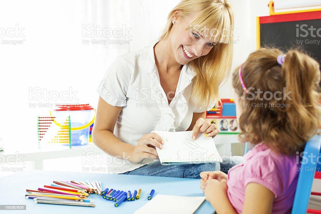 Speech Therapist Talking with child. stock photo