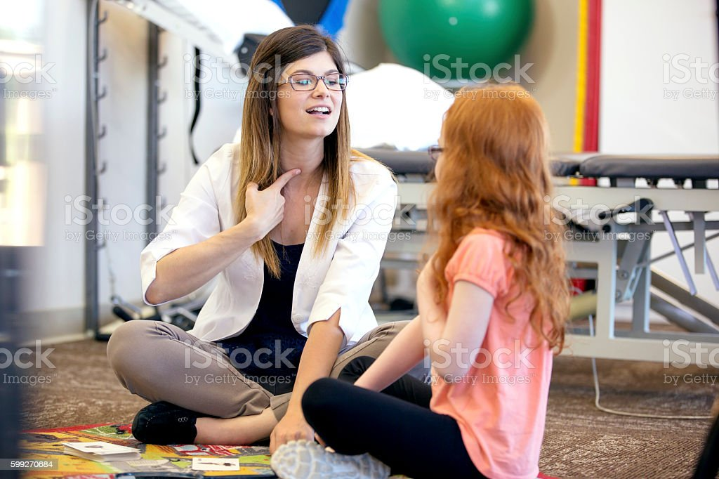 Speech therapist working with a young child stock photo