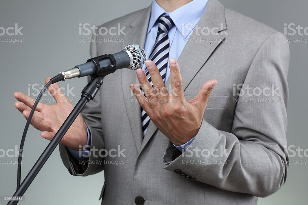 Speech with microphone and hand gesture stock photo