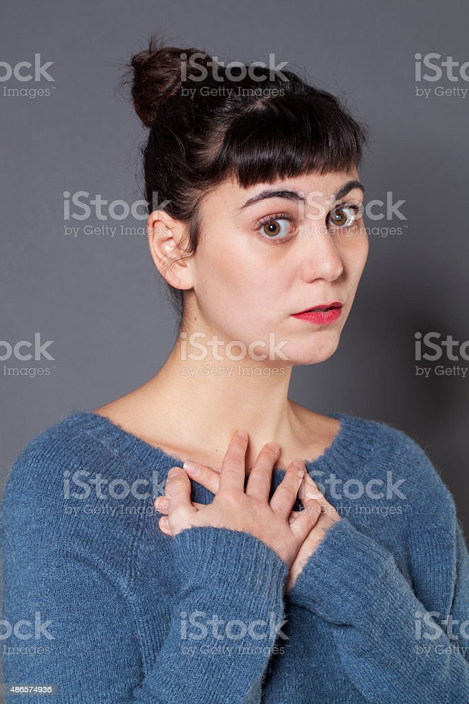 speechless 20s fair-skinned girl feeling pain and sadness stock photo