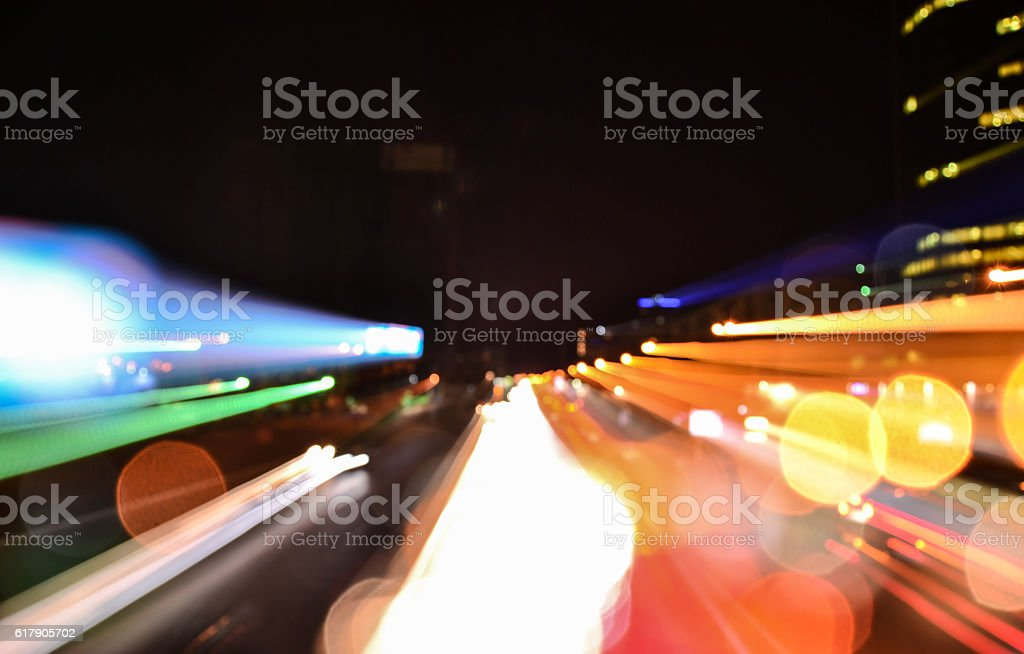 Speed accelerating blurred motion abstract multicolored background stock photo