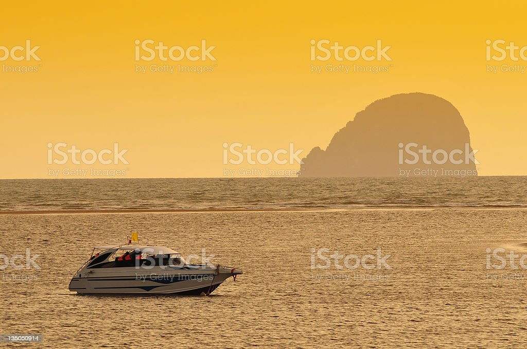 Speed boat on a sunset background stock photo