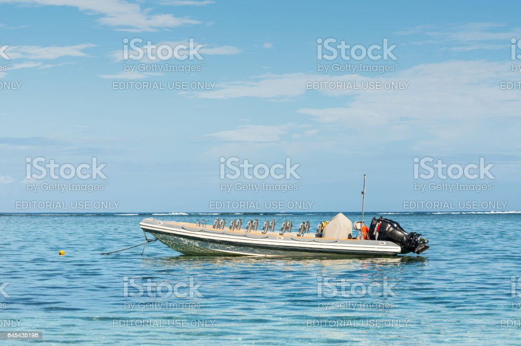 Speed boat on the Le Morne Beach stock photo