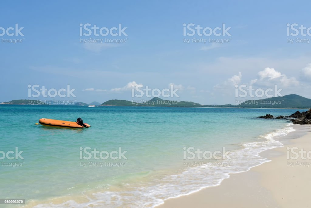 speed boat on the sand beach stock photo