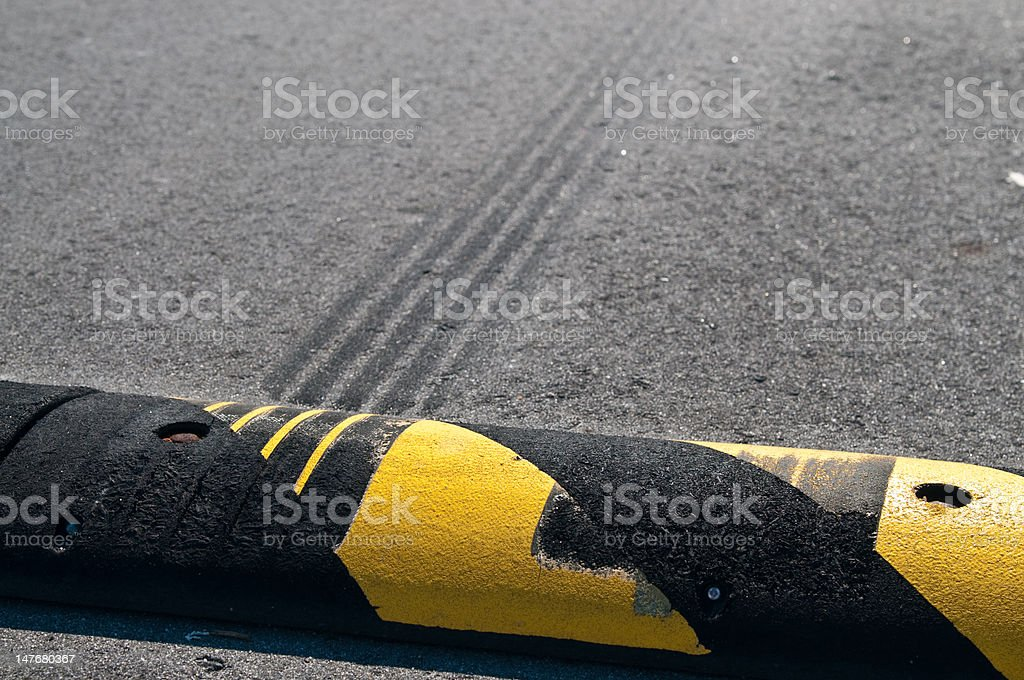Speed Bump and Burnt Rubber stock photo