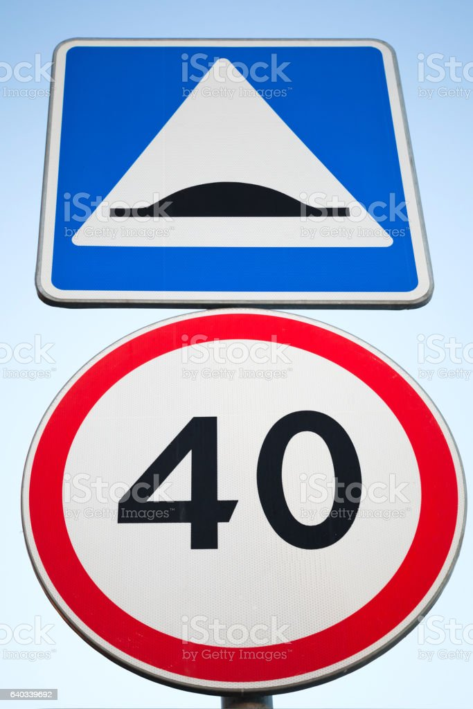 Speed Bump and speed limit. Road signs stock photo