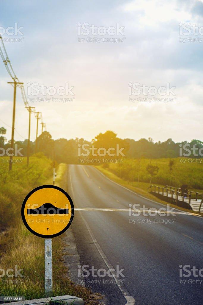 Speed bump caution yellow sign stock photo