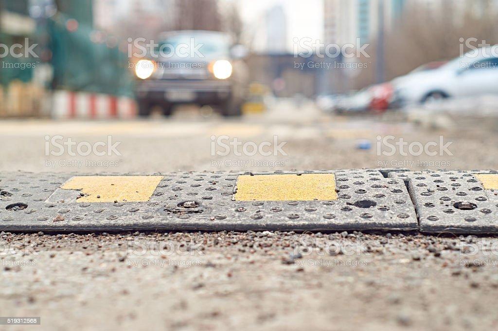 Speed bump closeup stock photo
