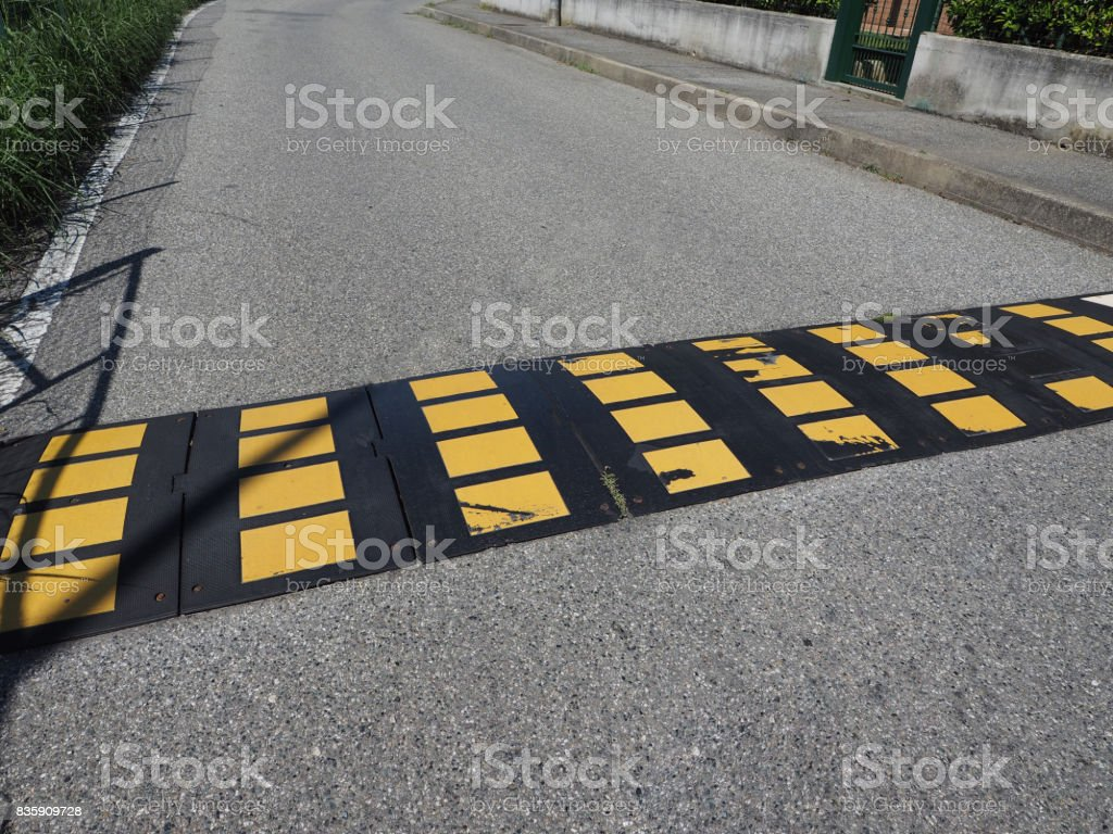 speed bump hump sign stock photo