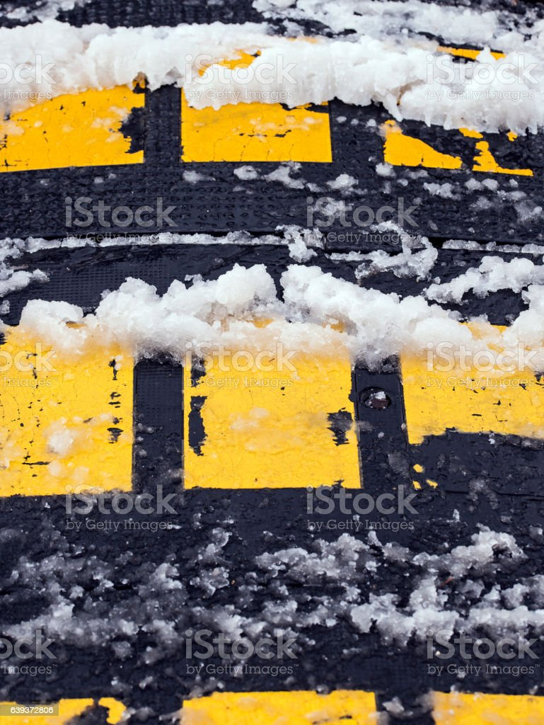Speed bump obstacle covered with snow. stock photo