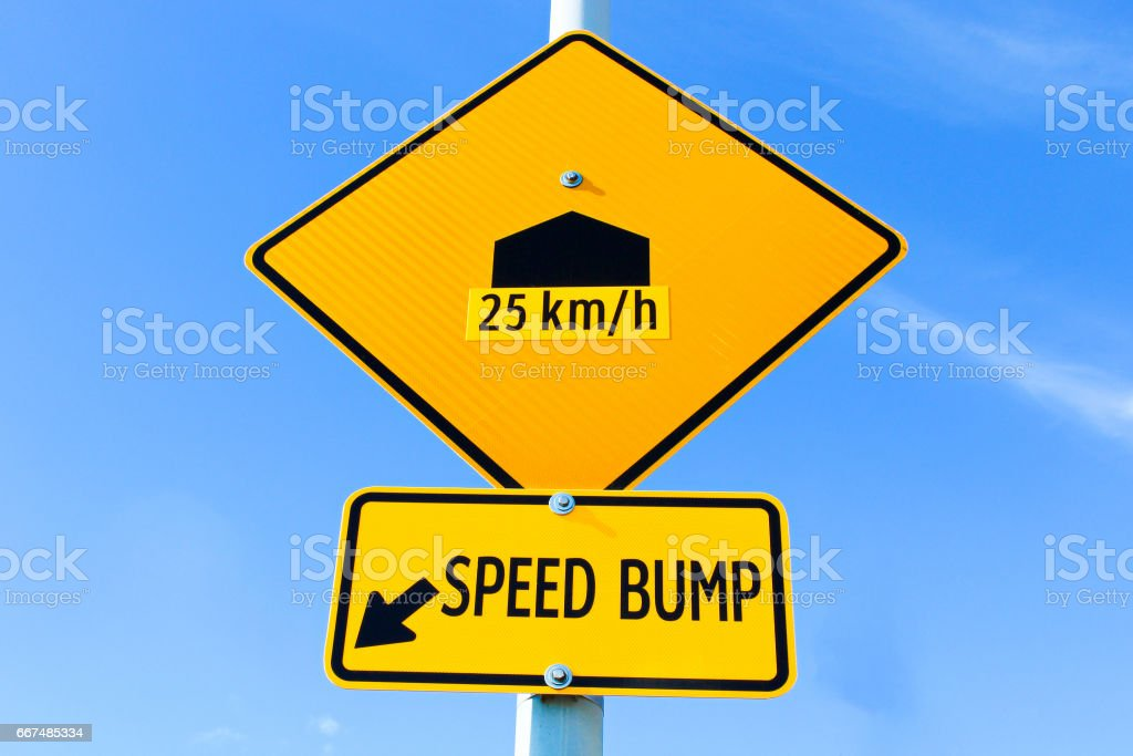 Speed bump sign with speed recommendation stock photo