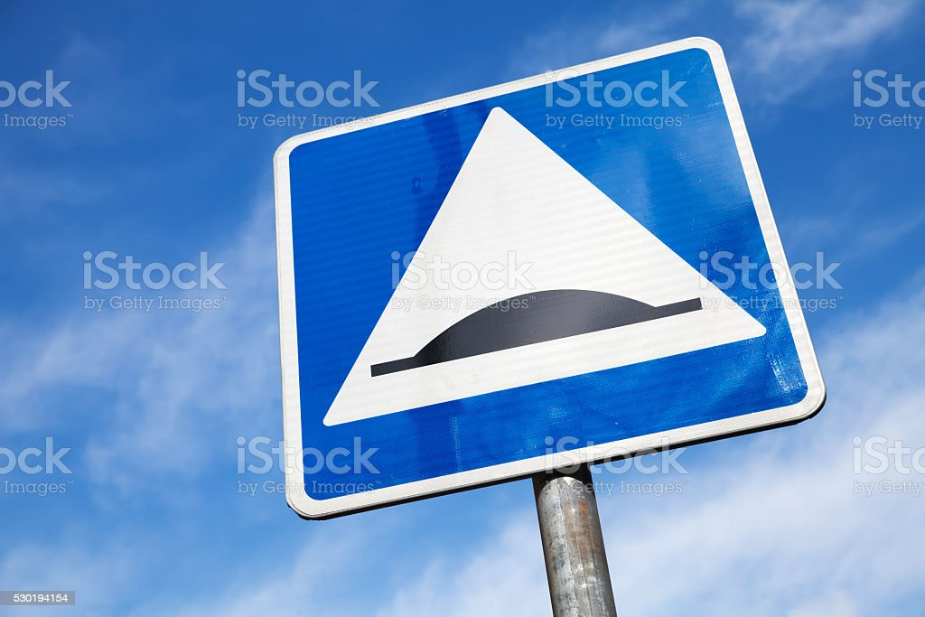 Speed Bump. Square road sign over cloudy sky stock photo
