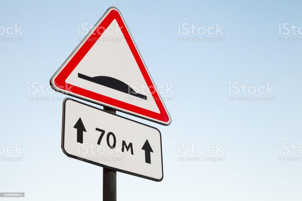Speed Bump. Warning road sign stock photo