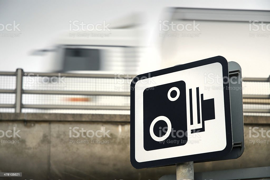 Speed Camera Sign and Blurred Truck stock photo