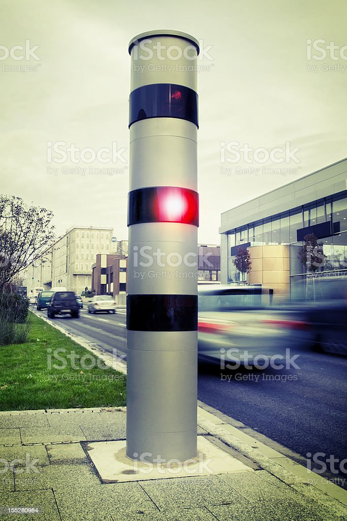 Speed camera with passing cars stock photo